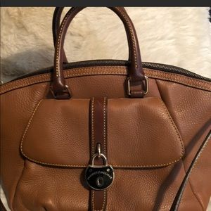 Dooney & Bourne satchel bag in saddle brown.
